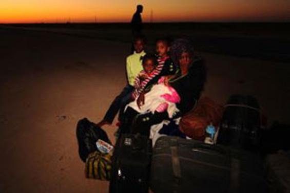 Libya'dan kaçan işçiler yardım bekliyor