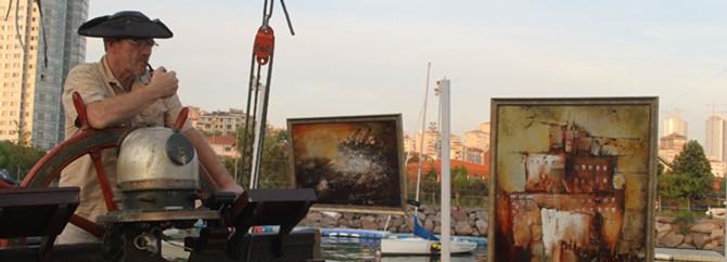Russian artist displays works on his schooner