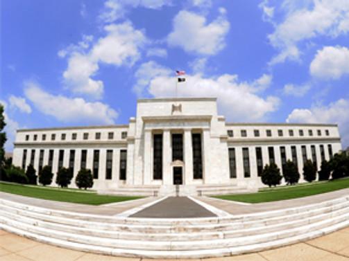 Fed büyüme tahminini indirdi
