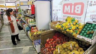 Topbaş, BİM hisselerini şirketine sattı