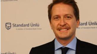 Standard Bank operasyonlarına devam ediyor