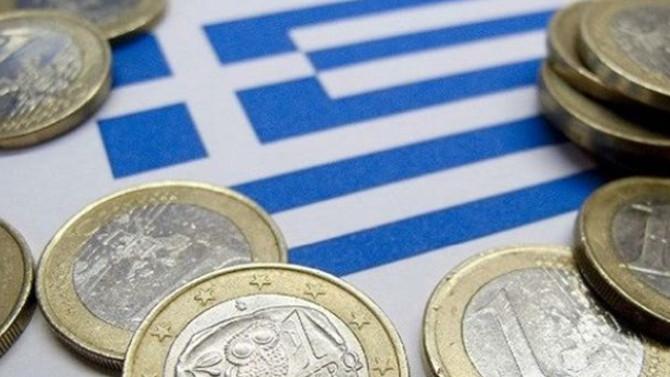 Yunanistan büyüme tahminini düşürdü