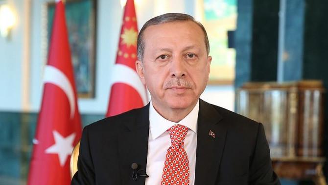 Erdoğan, Dursun Özbek'i kutladı