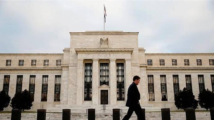 Fed, büyüme tahminini yükseltti