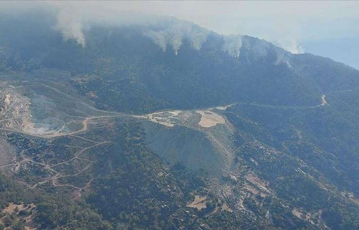 Aydın'dan Muğla'ya ulaşan orman yangını kontrol altına alındı