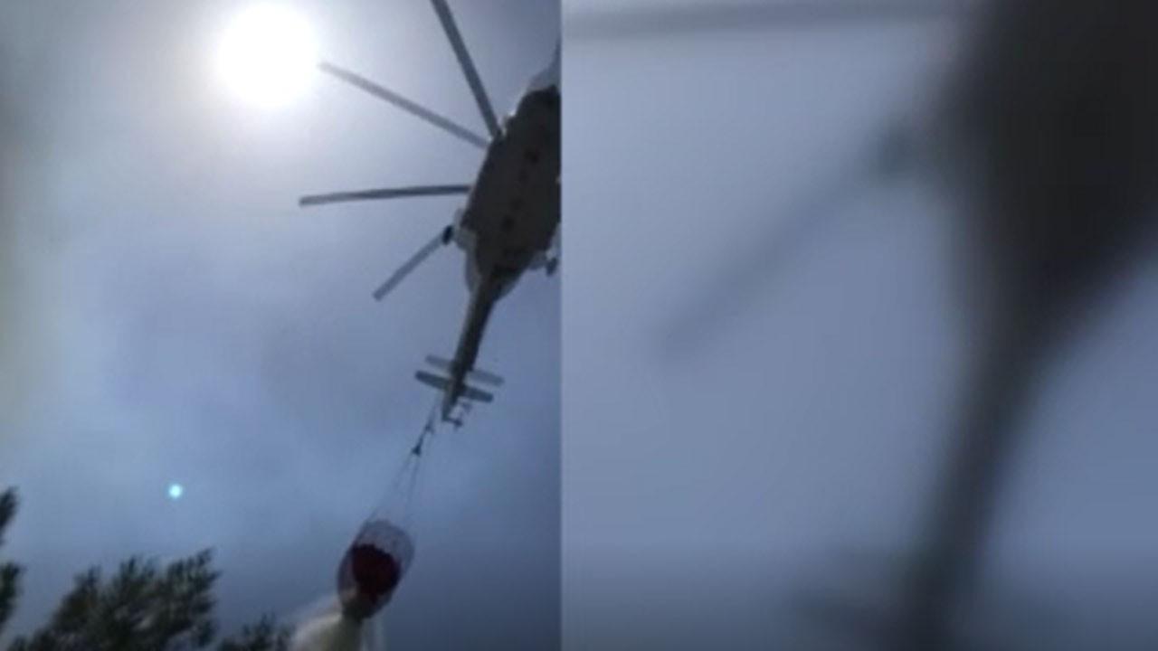 Yangına destek isterken helikopter üzerine su boşalttı
